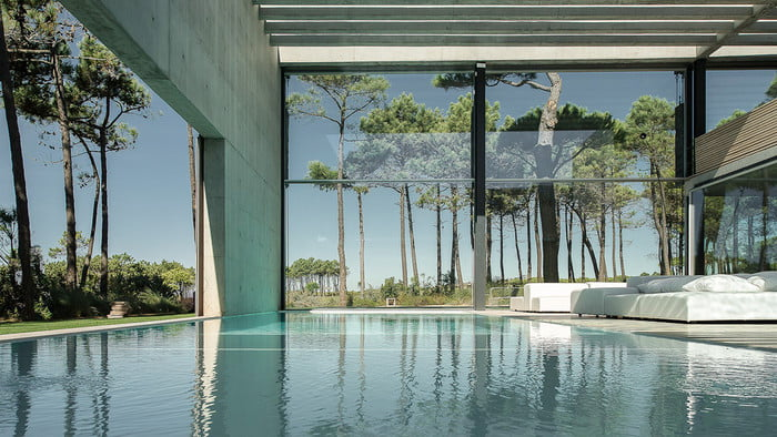 This Luxury Villa in Portugal has a Ridiculously Cool Glass Bottom Pool luxury villa This Luxury Villa in Portugal has a Ridiculously Cool Glass Bottom Pool guedes cruz the wall house 6 700x394 c