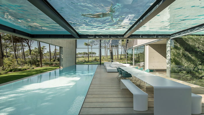 This Luxury Villa in Portugal has a Ridiculously Cool Glass Bottom Pool luxury villa This Luxury Villa in Portugal has a Ridiculously Cool Glass Bottom Pool guedes cruz the wall house 9 700x394 c